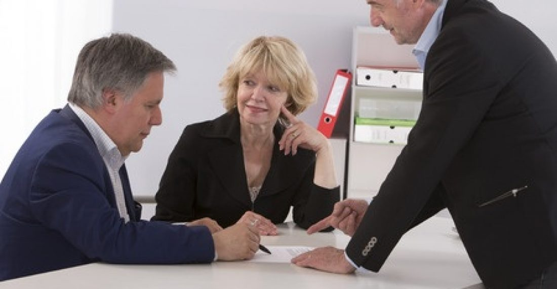 45626124 - senior couple writing signature under contract after financial consultation